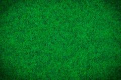 Grüner Teppich oder grüner Beschaffenheitshintergrund des woolen Gewebes lizenzfreies stockfoto