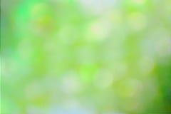 Grüner und gelber abstrakter defocused Hintergrund Stockbilder