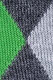 Grüner und grauer woolen dekorativer Gewebebeschaffenheitshintergrund, Abschluss oben Lizenzfreie Stockfotos