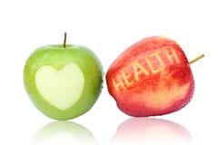 Grüner und roter Apfel lokalisiert auf weißem Hintergrund Stockfotos