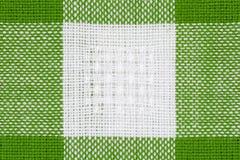 Grüner und weißer Tischdeckenbeschaffenheitshintergrund, Abschluss oben Lizenzfreie Stockfotos