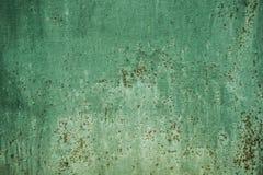 Grüner Wandbeschaffenheitshintergrund mit Rost Stockfotos