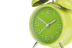 Grüner Wecker lokalisiert auf Weiß Stockfoto