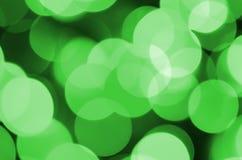 Grünes abstraktes Weihnachten unscharfer leuchtender Hintergrund Defocused künstlerisches bokeh beleuchtet Bild stockfotos