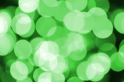 Grünes abstraktes Weihnachten unscharfer leuchtender Hintergrund Defocused künstlerisches bokeh beleuchtet Bild Stockfotografie