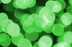 Grünes abstraktes Weihnachten unscharfer leuchtender Hintergrund Defocused künstlerisches bokeh beleuchtet Bild Lizenzfreie Stockfotos