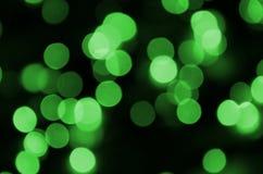 Grünes abstraktes Weihnachten unscharfer leuchtender Hintergrund Defocused künstlerisches bokeh beleuchtet Bild Stockfoto