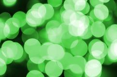 Grünes abstraktes Weihnachten unscharfer leuchtender Hintergrund Defocused künstlerisches bokeh beleuchtet Bild Lizenzfreies Stockfoto