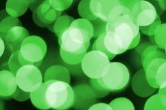 Grünes abstraktes Weihnachten unscharfer leuchtender Hintergrund Defocused künstlerisches bokeh beleuchtet Bild Stockbild