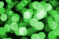Grünes abstraktes Weihnachten unscharfer leuchtender Hintergrund Defocused künstlerisches bokeh beleuchtet Bild Lizenzfreie Stockbilder
