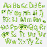Grünes Alphabet der Karikatur mit Augen Lizenzfreies Stockbild