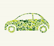 Grünes Auto mit Ikonen Stockfotografie