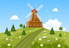 Grünes Feld und Mühle Lizenzfreies Stockbild