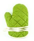 Grünes Geschirr oder Küchenhandschuh Stockfoto