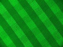 Grünes gestreiftes Gewebe Stockfotografie