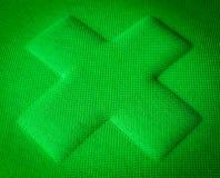 Grünes Gewebe-Kreuz Stockfotografie
