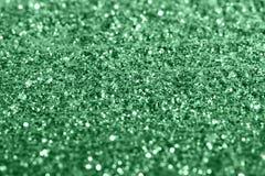Grünes giltter masern festlichen abstrakten Hintergrund, Werkstück für Entwurf, weiches focu stockfotos