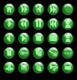 Grünes Glas-Tasten auf einem schwarzen Hintergrund Stockfotografie