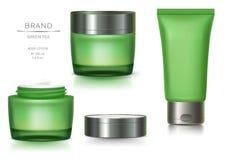 Grünes Glasgefäß und Kunststoffrohr stockfotografie