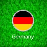 Grünes Gras und Kreis mit Flagge von Deutschland Stockbild