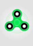 Grünes Handspinner-Unruhespielzeug Stockfotos