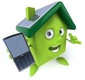 Grünes Haus mit Sonnenkollektoren lizenzfreie abbildung