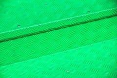 Grünes Metalldiamant-Bodenplattelicht und -schatten masern Hintergrund lizenzfreie stockfotografie