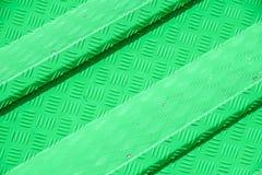 Grünes Metalldiamant-Bodenplattelicht und -schatten masern Hintergrund lizenzfreie stockbilder