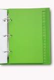 Grünes Notizbuch lizenzfreies stockbild