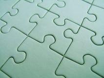 Grünes Puzzlespiel stockfotografie