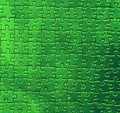 Grünes Puzzlespielmuster Lizenzfreies Stockfoto