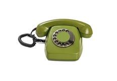 Grünes Retro- Telefon lokalisiert auf weißem Hintergrund Stockfotografie