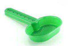 Grünes Siebspielzeug lizenzfreies stockbild