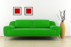 Grünes Sofa und Vase mit trockenem Holz Stockbild