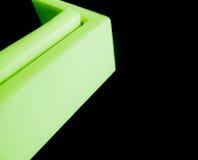 Grünes Sofaeckdesign auf einem schwarzen Teppich Stockfoto