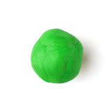 Grünes Stück Plastik auf einem weißen Hintergrund Stockfotos