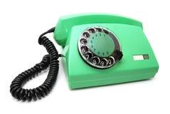 Grünes Telefon mit einer Platte Stockbilder