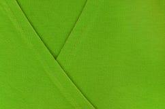 Grünes Textilmuster mit faltender Form Lizenzfreie Stockfotos