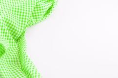 Grünes Tischdeckengewebe auf weißem Hintergrund Stockfotos