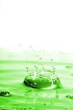 Grünes Wasser-Spritzen Lizenzfreie Stockfotos