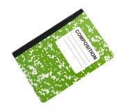 Grünes Zusammensetzungsnotizbuch auf einem weißen Hintergrund Stockbild