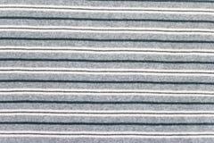 Grå bakgrund för textur för bomullstyg Fotografering för Bildbyråer