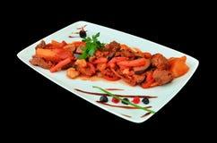 grönsaker för sås för nötköttkokkonst romanian Arkivbilder