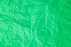 Gr?splan skrynklig pappers- bakgrund royaltyfri foto
