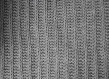 Grå stickade plaggbakgrund Arkivbilder