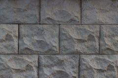 Gr? v?gg f?r sten av texturerade stenar f?r bakgrunden arkivbilder