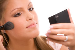 göra makeupkvinnan Royaltyfria Foton