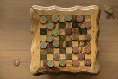 Gra warcaby - USA centy VS eurocents Zdjęcia Stock