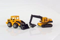 Graafwerktuigstuk speelgoed op geïsoleerd Royalty-vrije Stock Foto's