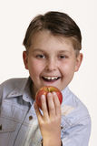 Grab an apple. Heallthy Kids....Young boy holding an apple royalty free stock photo